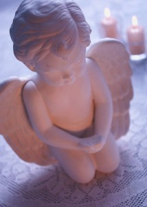 angel-statue-with-candles
